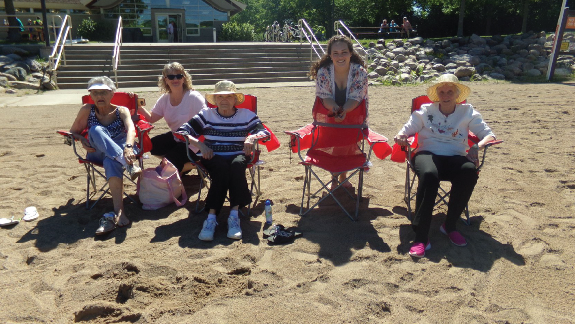 Team members and residents enjoying sand and sun